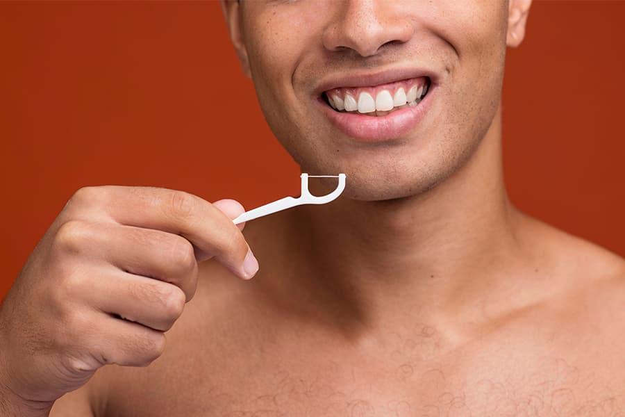 como usar el hilo dental